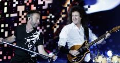 Singer Paul Rodgers and Brian May, from left, of British band Queen